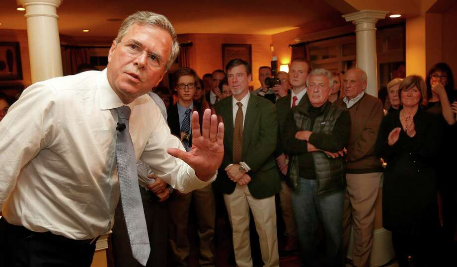 Presidential candidate Jeb Bush waves to guests before speaking at a house party campaign stop in Bedford, N.H. Bush recently proposed boots on the ground in Syria. A reader has a suggestion for the former Florida governor. Photo: Jim Cole /Associated Press / AP