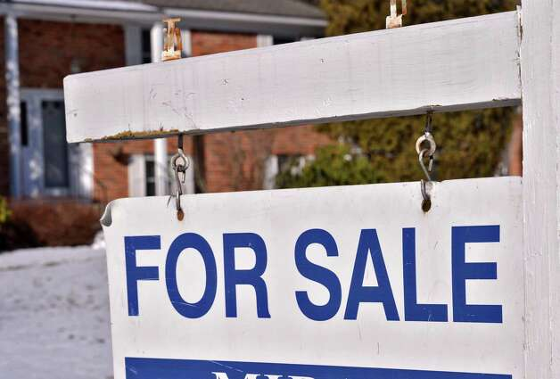 For sale sign outside a home on Hickory Road in Niskayuna Tuesday Jan. 22, 2013. (John Carl D'Annibale / Times Union) Photo: John Carl D'Annibale / 00020842A