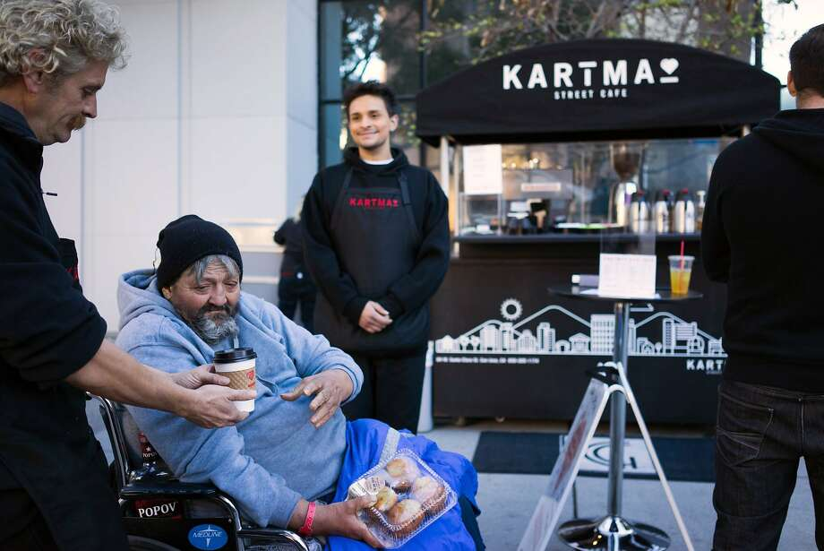 Richard Hess gives a hot chocolate to Lourdes Siegfried in downtown San Jose, Calif. on Thursday, Nov. 12, 2015. Kartma is run by people transitioning out of homelessness. Photo: James Tensuan, Special To The Chronicle