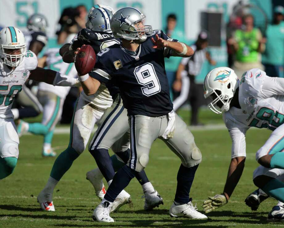 Dallas Cowboys quarterback Tony Romo throws during the first half against the Miami Dolphins. Sunday marks the first weekend of NFL action, kicking off an annual ritual for state lobbyists: gifting tens of thousands of dollars in tickets to lawmakers for Cowboys and Texans games.  Photo: Wilfredo Lee /Associated Press / AP