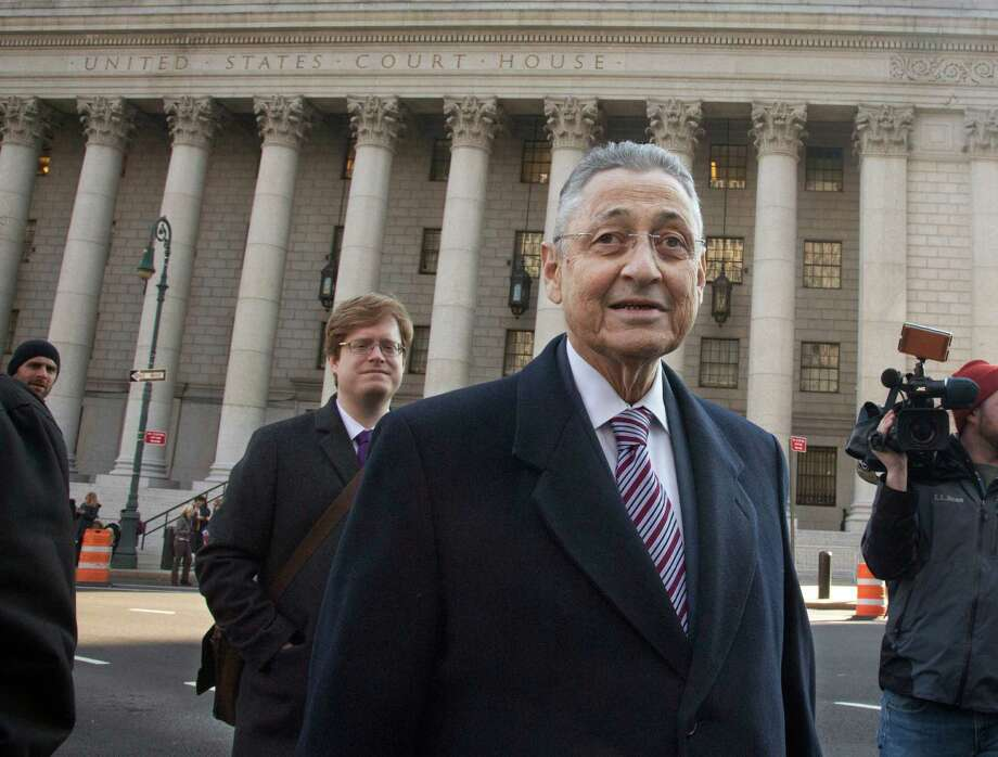 Former New York Assembly Speaker Sheldon Silver, center, leaves court after jurors took a break in Silver's federal corruption trial, Wednesday, Nov. 25, 2015, in New York.  Jurors worked through the morning and then adjourned for the long holiday weekend. Deliberations will resume on Monday, Nov. 30. (AP Photo/Bebeto Matthews) ORG XMIT: NYBM109 Photo: Bebeto Matthews / AP