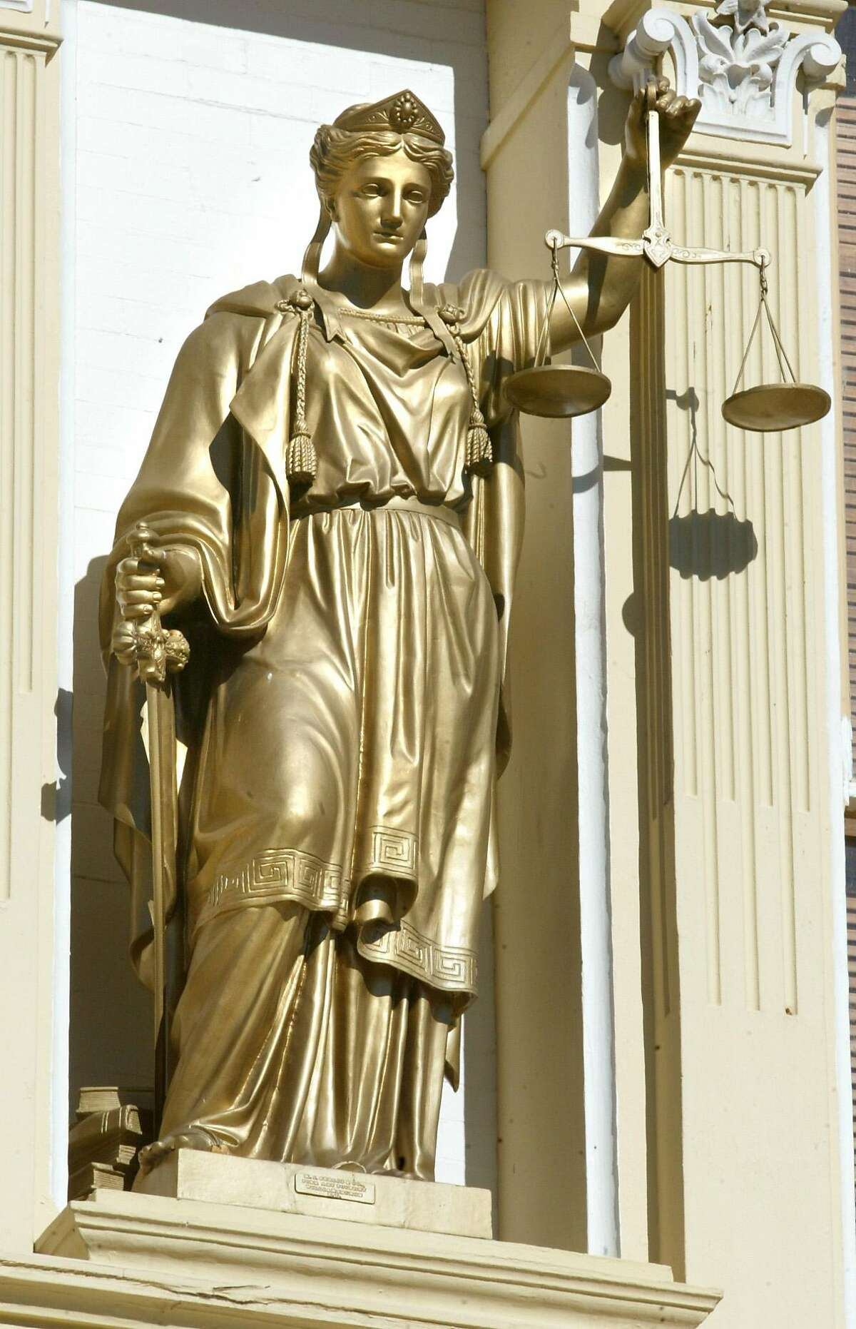 TRAVEL ** FILE **Justice is not blind in Virginia City, Nev. Bucking convention, the statue of Lady Liberty, who holds the Scales of Justice on the 1876 Washoe County Court House, wears no blindfold, seen in this June 2003 file photo. Virginia City stands today as the largest historic district in the United States. Much of the town is preserved and restored to the way it was when it was rebuilt from a consuming fire in 1875. (AP Photo/Orange County Register, Jebb Harris)