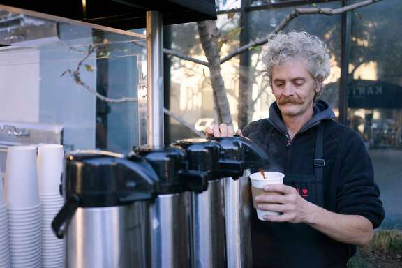 Richard Hess pours coffee for a customer in downtown San Jose, Calif. on Thursday, Nov. 12, 2015. Kartma is run by people transitioning out of homelessness.