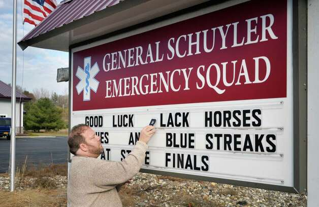 J.R. Hanna of the General Schuyler Emergency Squad on Route 29, uses their sign to wish our local teams good luck in the upcoming high school football state championships at the Carrier Dome in Syracuse Tuesday Nov. 24, 2015 in Saratoga Springs, NY.  (John Carl D'Annibale / Times Union) Photo: John Carl D'Annibale / 10034414A