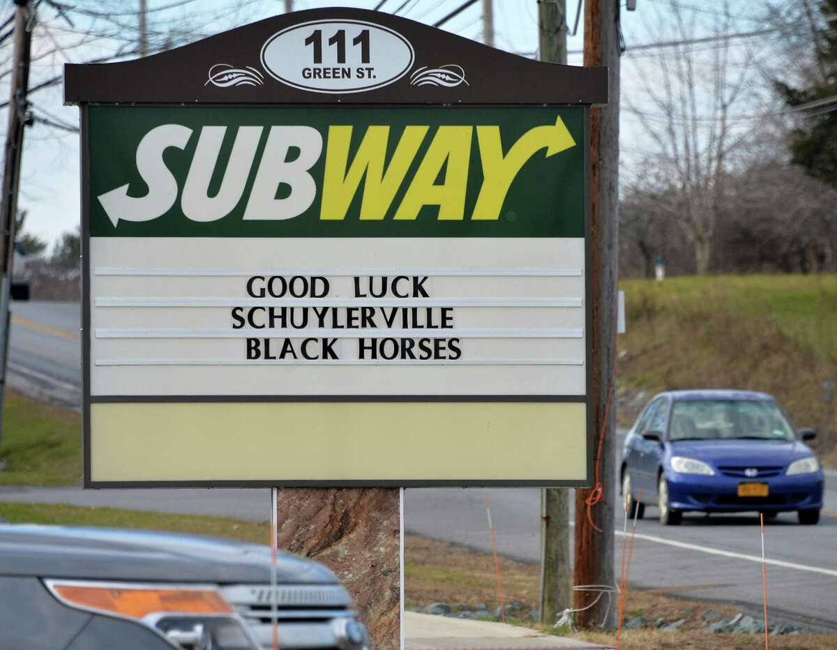 The sign outside the Subway shop on Route 29, wishing The Schuylerville Black Horses good luck in their upcoming high school football state championships at the Carrier Dome in Syracuse Tuesday Nov. 24, 2015 in Schuylerville, NY. (John Carl D'Annibale / Times Union)