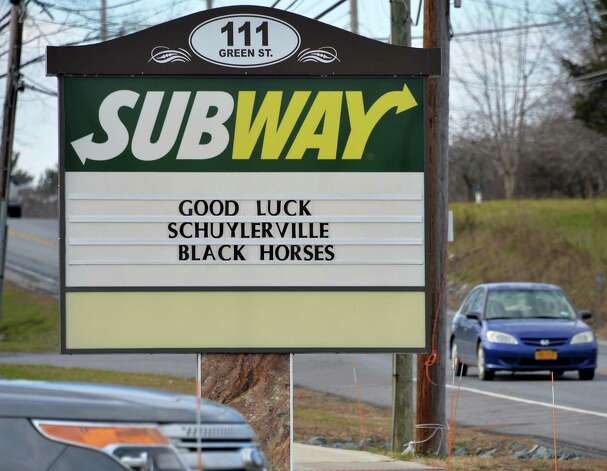 The sign outside the Subway shop on Route 29, wishing The Schuylerville Black Horses good luck in their upcoming high school football state championships at the Carrier Dome in Syracuse Tuesday Nov. 24, 2015 in Schuylerville, NY.  (John Carl D'Annibale / Times Union) Photo: John Carl D'Annibale / 10034414A