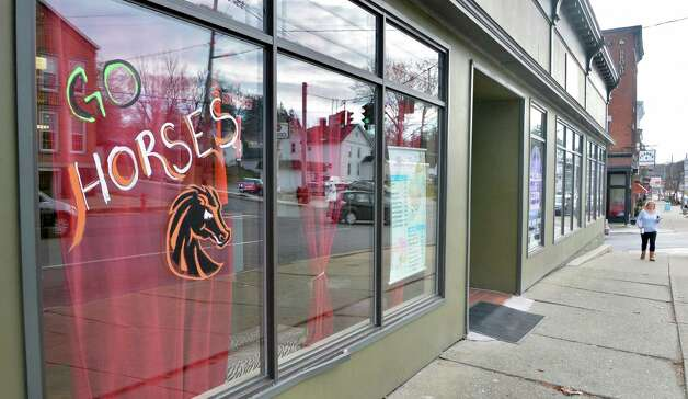 A sign on the window of Hair Diva on Broadway wishing The Schuylerville Black Horses good luck in their upcoming high school football state championships at the Carrier Dome in Syracuse Tuesday Nov. 24, 2015 in Schuylerville, NY.  (John Carl D'Annibale / Times Union) Photo: John Carl D'Annibale / 10034414A