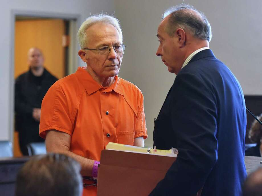 From left, Bruce Leonard stands with his defense attorney Don Gerace in the courtroom at the Oneida County Courthouse in Utica, N.Y. on Wednesday, Nov. 25, 2015. Several members including Leonard of an insular upstate New York church have pleaded not guilty to being part of a group that beat a young man to death and injured his younger brother. (Mark DiOrio/Observer-Dispatch via AP) ROME OUT; MANDATORY CREDIT ORG XMIT: NYUTI126 Photo: Mark DiOrio / Observer-Dispatch