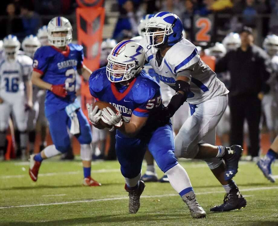 Saratoga's Eric Stone, center, intercepts a pass intended for Shaker's Brandon Barlow, right, during their Class AA football championship game on Friday, Nov. 6, 2015, at Shenendehowa High in Clifton Park, N.Y. (Cindy Schultz / Times Union) Photo: Cindy Schultz / 00034111A
