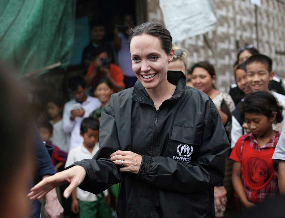 FILE - In this July 30, 2015, file photo, actress Angelina Jolie Pitt, United Nations High Commissioner for Refugees special envoy and co-founder of the Preventing Sexual Violence Initiative, visits Jan Mai Kaung refugee camp in Myitkyina, Kachin State, Myanmar. The little-known Cambodia International Film Festival is getting a star-powered boost this year from Jolie Pitt. The Hollywood star, who is currently in Cambodia filming her latest movie, will serve as president of the festival's honorary committee, organizers said. (AP Photo/Hkun Lat, File) ORG XMIT: TOK102 Photo: Hkun Lat / AP
