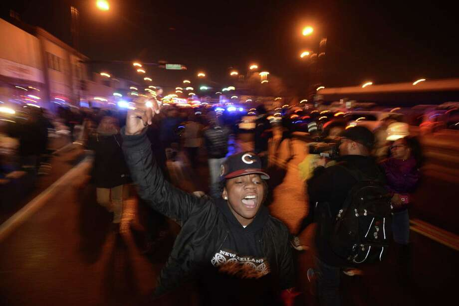 Protesters march during a demonstration  for 17-year-old Laquan McDonald, who was fatally shot and killed Oct. 20, 2014 in Chicago. Chicago police officer Jason Van Dyke was charged Tuesday, Nov. 24, 2015, with first degree murder in the killing. (AP Photo/Paul Beaty) ORG XMIT: ILPB134 Photo: Paul Beaty / FR36811