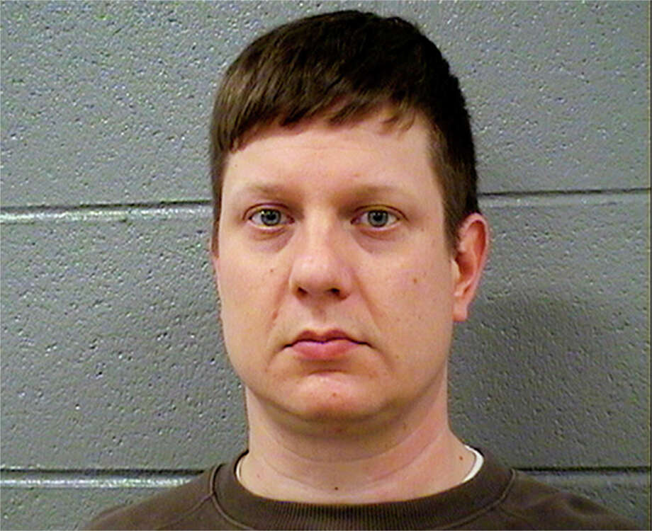 This Tuesday, Nov. 24, 2015 photo released by the Cook County Sheriff's Office shows Chicago police Officer Jason Van Dyke, who was charged Tuesday with first degree murder in the killing of 17-year-old Laquan McDonald on Oct. 20, 2014. (Cook County Sheriff's Office via AP) ORG XMIT: CX102 / Cook County Sheriff's Office