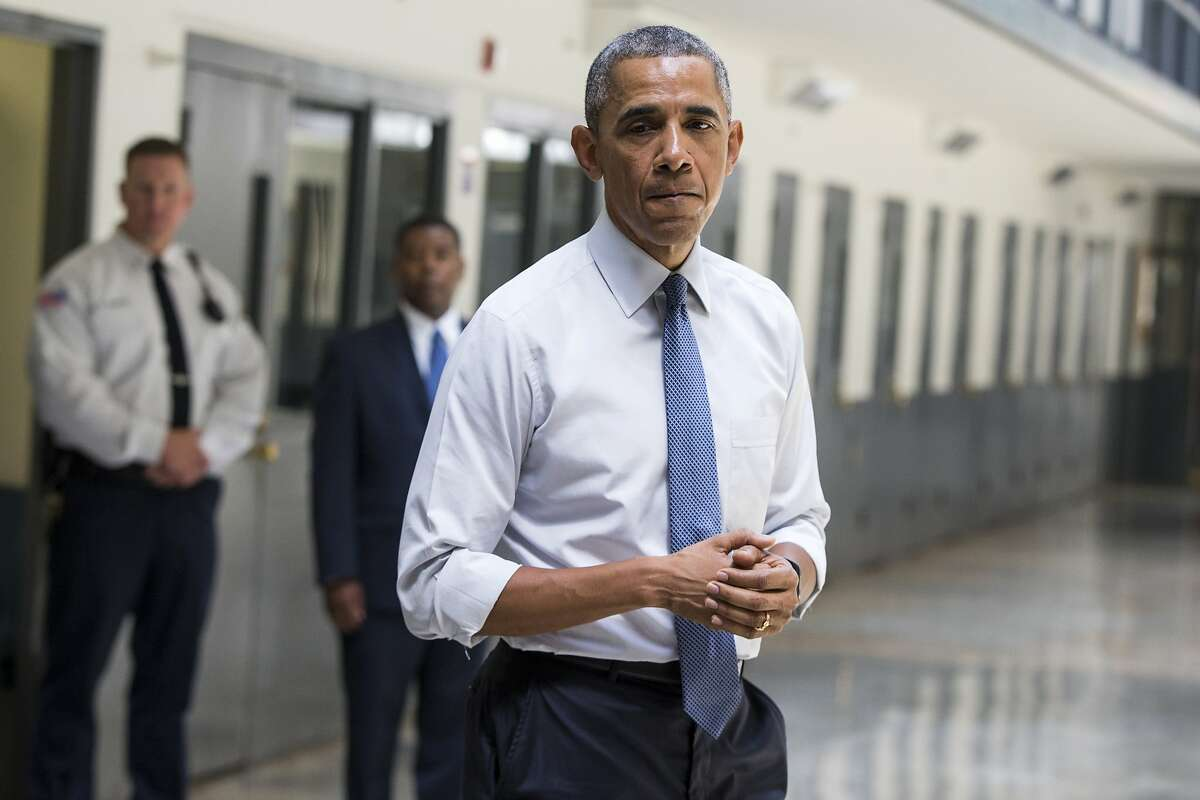 """CORRECTS TO REMOVE REFERENCE OF NUMBER OF INMATES - FILE - In this July 16, 2015, file photo, President Barack Obama pauses as he speaks at the El Reno Federal Correctional Institution in El Reno, Okla. An HBO documentary, """"Fixing the System"""", that features President Obama's historic visit to the prison, and his in-depth conversations with six of the inmates premiered Wednesday, Sept. 23, at the prison before a group of inmates. (AP Photo/Evan Vucci, File)"""