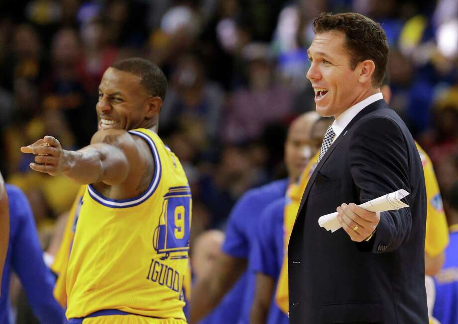 Golden State Warriors forward Andre Iguodala (9) and interim coach Luke Walton smile during the second half of an NBA basketball game against the Los Angeles Lakers in Oakland, Calif., Tuesday, Nov. 24, 2015. The Warriors won 111-77. (AP Photo/Jeff Chiu) ORG XMIT: OAS114 Photo: Jeff Chiu / AP