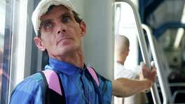 Bobby Depper travels north on the Metro light rail, on his way to find, feed and help homeless people.