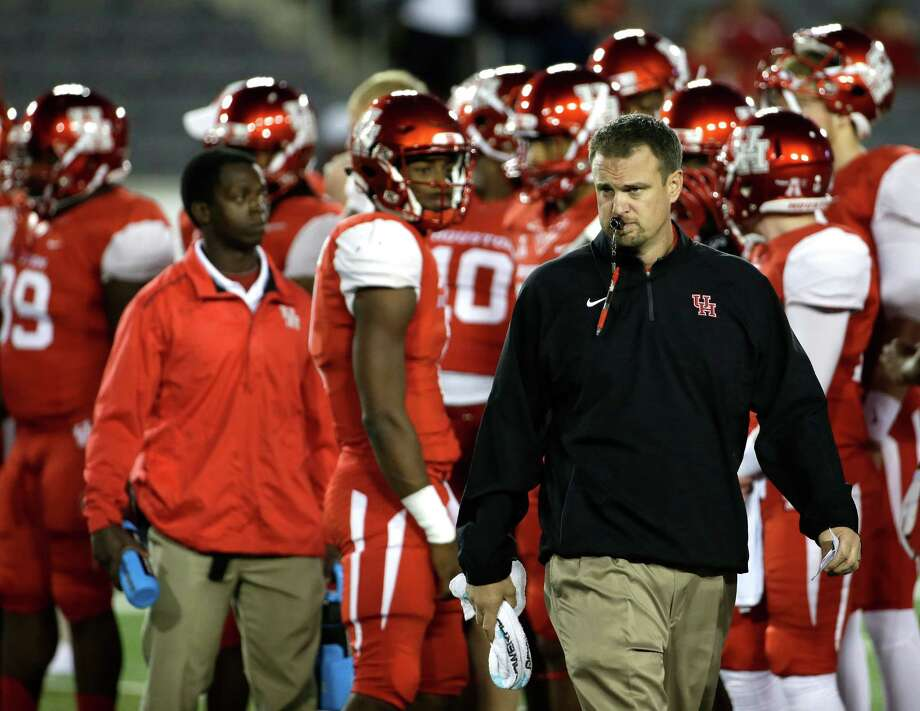 Houston coach Tom Herman watches his team warm up before an NCAA college football game against Memphis Saturday, Nov. 14, 2015, in Houston. (AP Photo/David J. Phillip) Photo: David J. Phillip, STF / AP