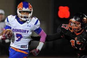 Ridgefield rolls past Danbury 48-20 - Photo