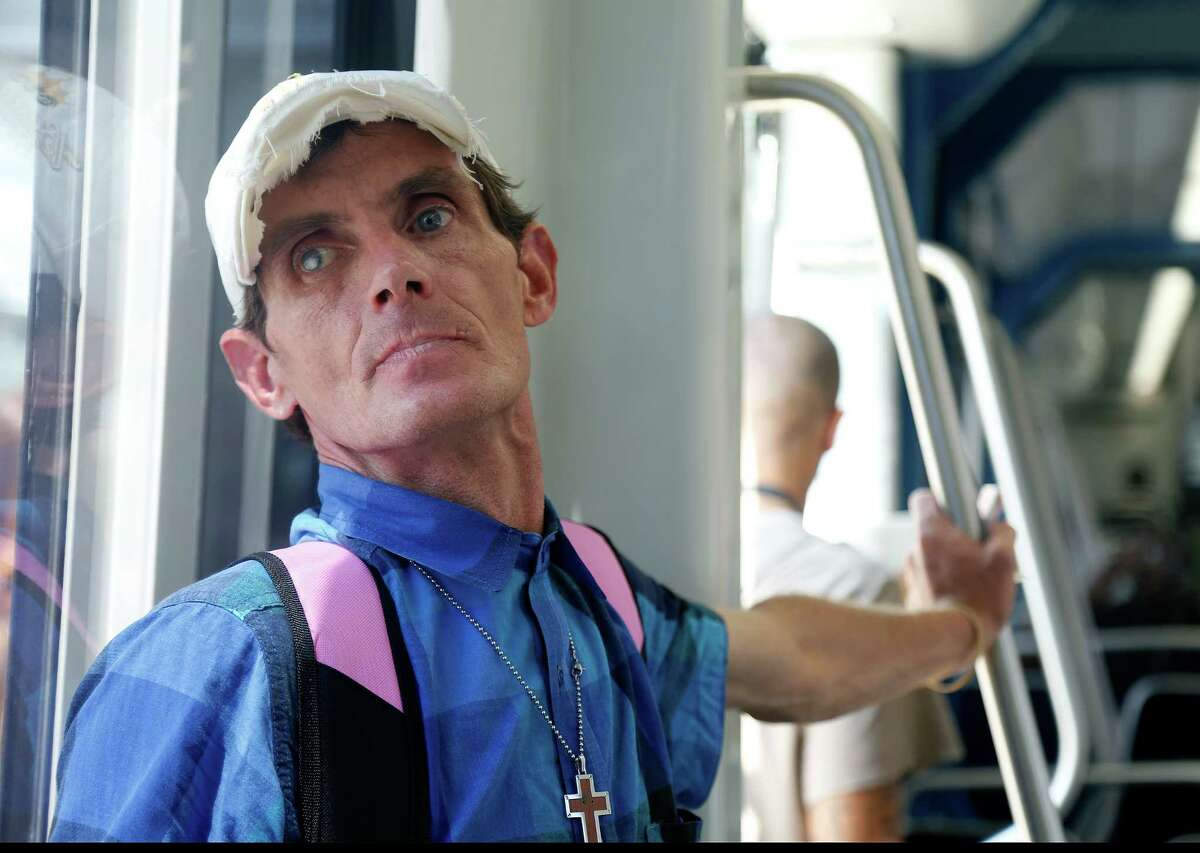 Bobby Depper looks out of the windows traveling north on the Metro light rail on his way to find, feed and try to help homeless people, Wednesday, Sept. 30, 2015. Depper prides himself on being able to spot people in need and moves quickly to catch people he thinks he can help. Depper, homeless and dying of AIDS, moved to Texas six months ago, and helps homeless people in the name of Jesus.