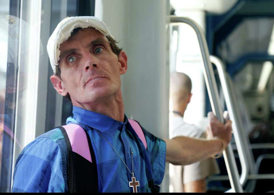 Bobby Depper looks out of the windows traveling north on the Metro light rail on his way to find, feed and try to help homeless people, Wednesday, Sept. 30, 2015. Depper prides himself on being able to spot people in need and moves quickly to catch people he thinks he can help. Depper, homeless and dying of AIDS, moved to Texas six months ago, and helps homeless people in the name of Jesus. Photo: Mark Mulligan, Houston Chronicle / © 2015 Houston Chronicle