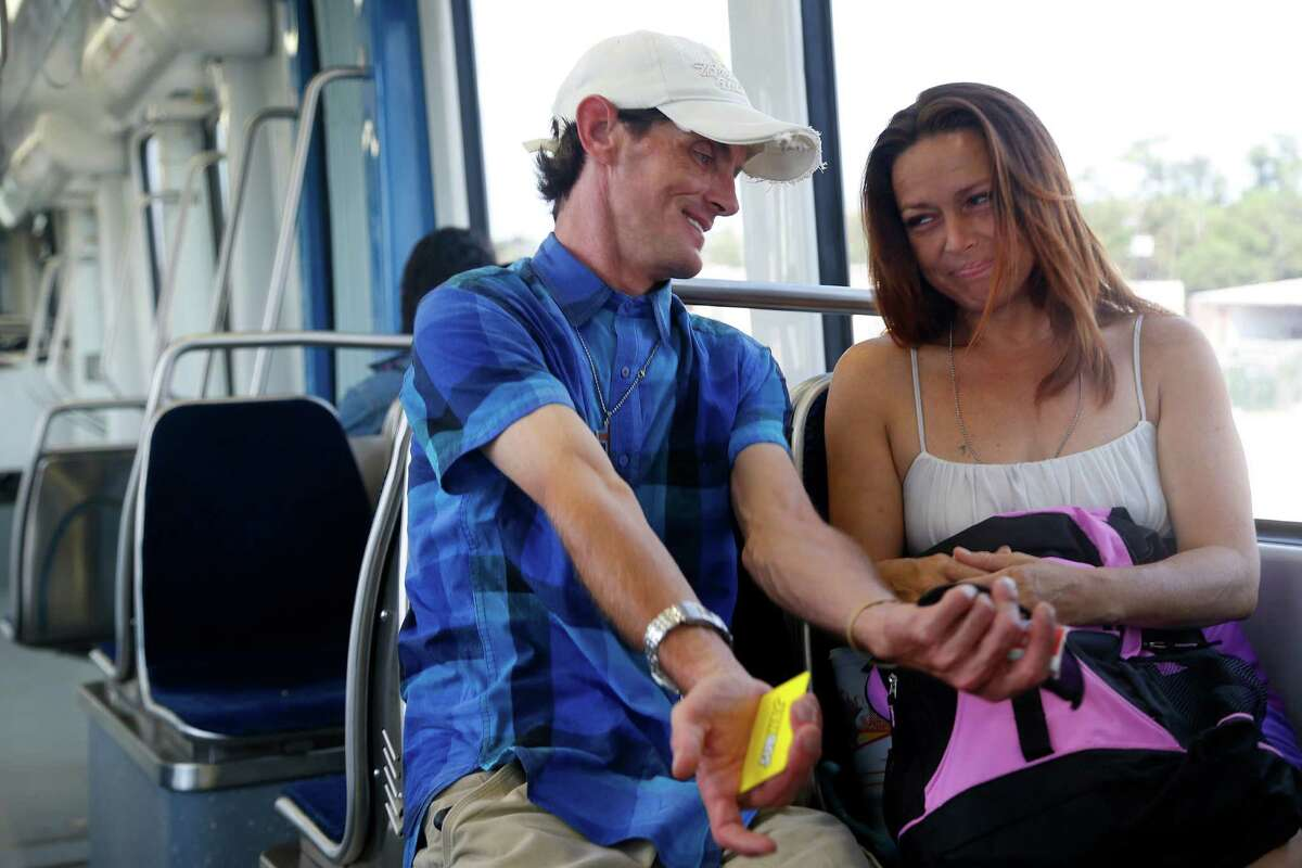 Bobby Depper shares stories with Trixy Hebert after meeting her on the light rail, Wednesday, Sept. 30, 2015. Hebert has been living on the streets and was desperately in need of supplies and the smile and prayer Depper provided, she said.