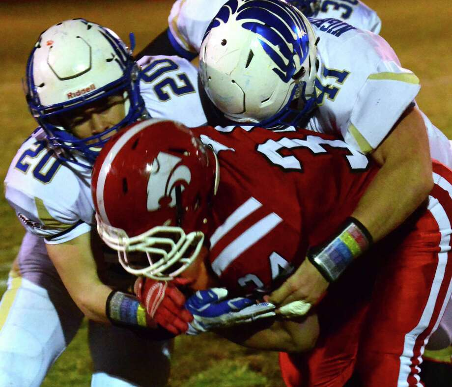 High school football action between Masuk and Newtown in Monroe, Conn. on Wednesday Nov. 25, 2015. Photo: Christian Abraham / Hearst Connecticut Media / Connecticut Post