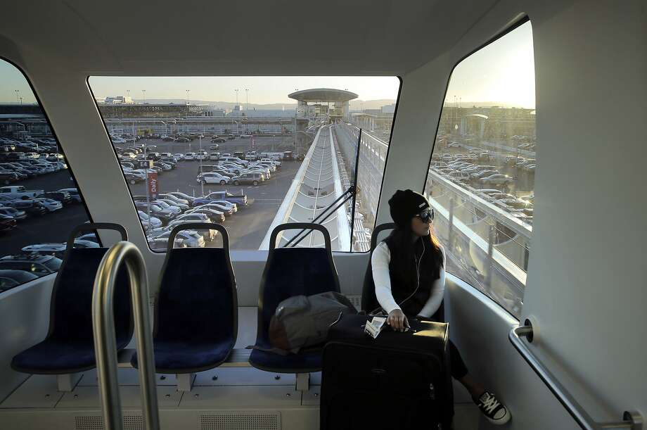 Julia Garrida rides on the Oakland Airport Connector between Oakland International Airport and the Coliseum BART Station in Oakland, Calif., on Wednesday, November 25, 2015. Photo: Carlos Avila Gonzalez, The Chronicle