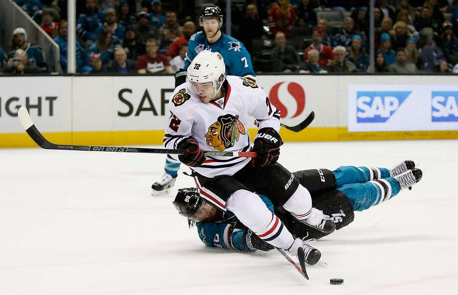 Sharks defenseman Brent Burns slides into the legs of Chicago's Artemi Panarin. The play resulted in a tripping call on Burns. Photo: Ezra Shaw, Getty Images