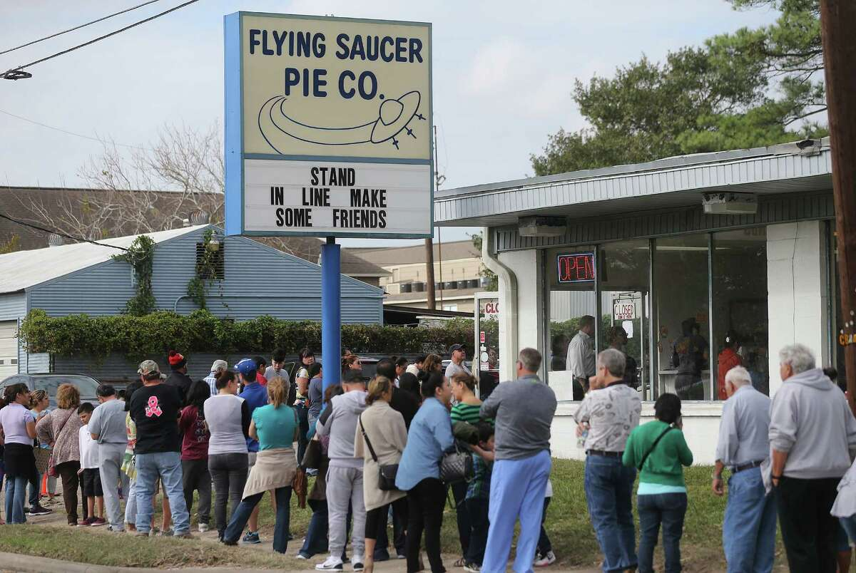 Flying Saucer Pie Co., consumers wait in line to buy a pie for the holiday on on Wednesday, Nov. 25, 2015, in Houston.