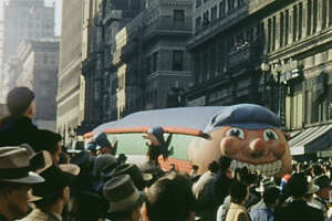 A 150 foot train balloon.  A hundred thousand people attended the San Francisco's holiday balloon parade on Thanksgiving Day, Nov. 27, 1952.