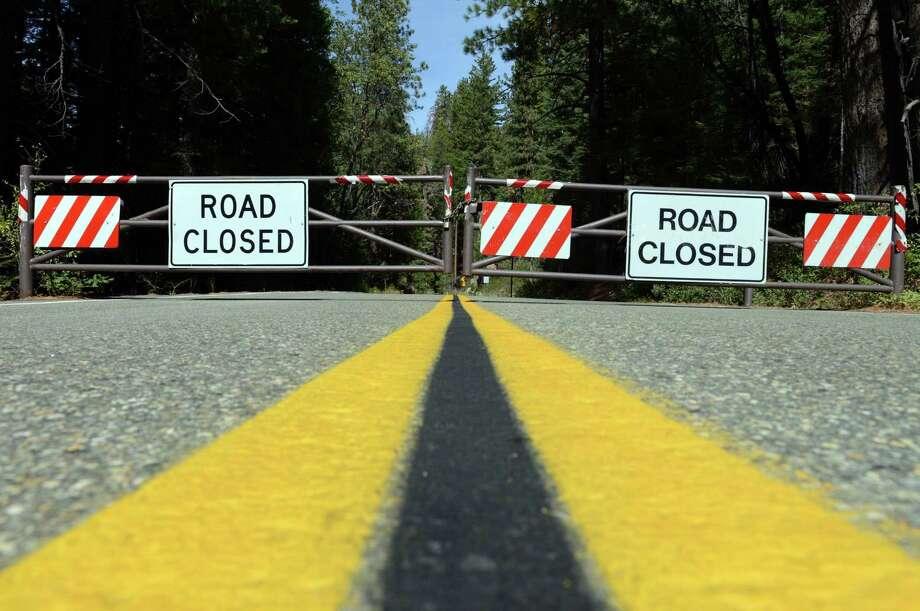 File photo of a road closure. (Craig Kohlruss/Fresno Bee/MCT) Photo: CRAIG KOHLRUSS / McClatchy-Tribune News Service / Fresno Bee
