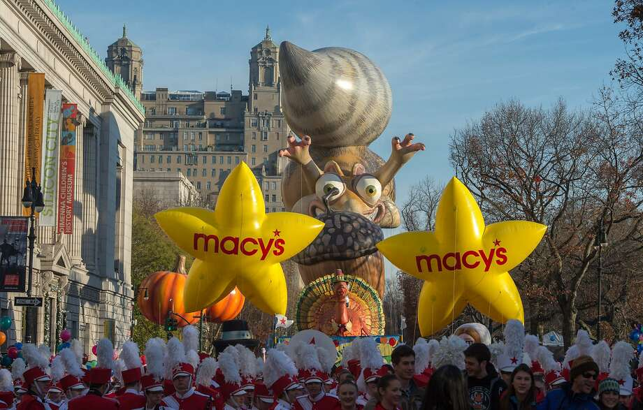 Performers stand in front of balloons at the start of the Macy's Thanksgiving Day Parade, Thursday Nov. 26, 2015, in New York.  Photo: Bryan R. Smith, Associated Press