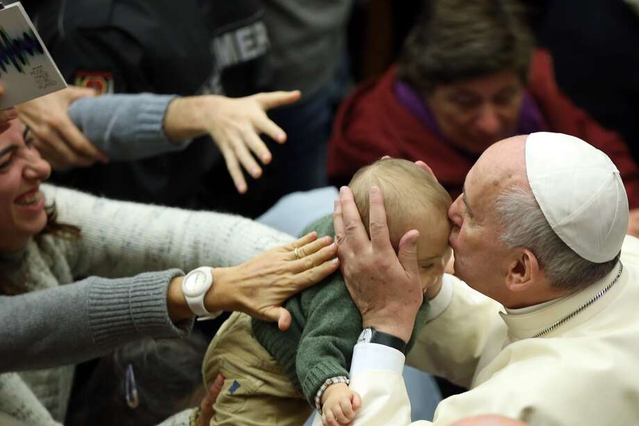 Pope Francis kisses a baby as he leaves the Paul VI Hall at the end of an audience for the health workers on November 22, 2014 in Vatican City, Vatican. Speaking to participants at a three-day conference sponsored by the Pontifical Council for Pastoral Health Care on Autism Spectrum Disorders, Pope Francis has urged concrete solidarity for people suffering from Autism spectrum disorders. Photo: Franco Origlia, Getty Images