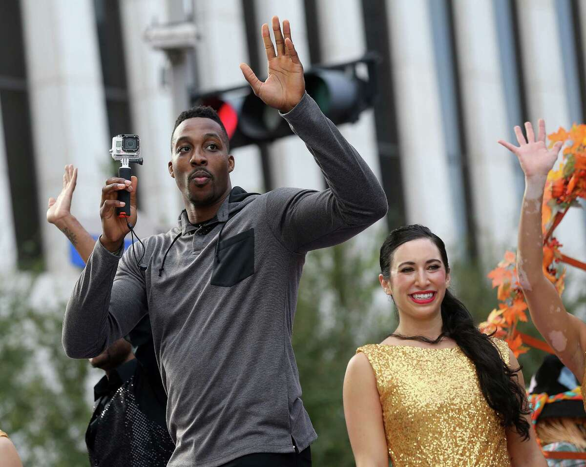 Houston Rockets' Dwight Howard is the grand marshall for the 66th Annual HEB Thanksgiving Day in downtown on Thursday, Nov. 26, 2015, in Houston.