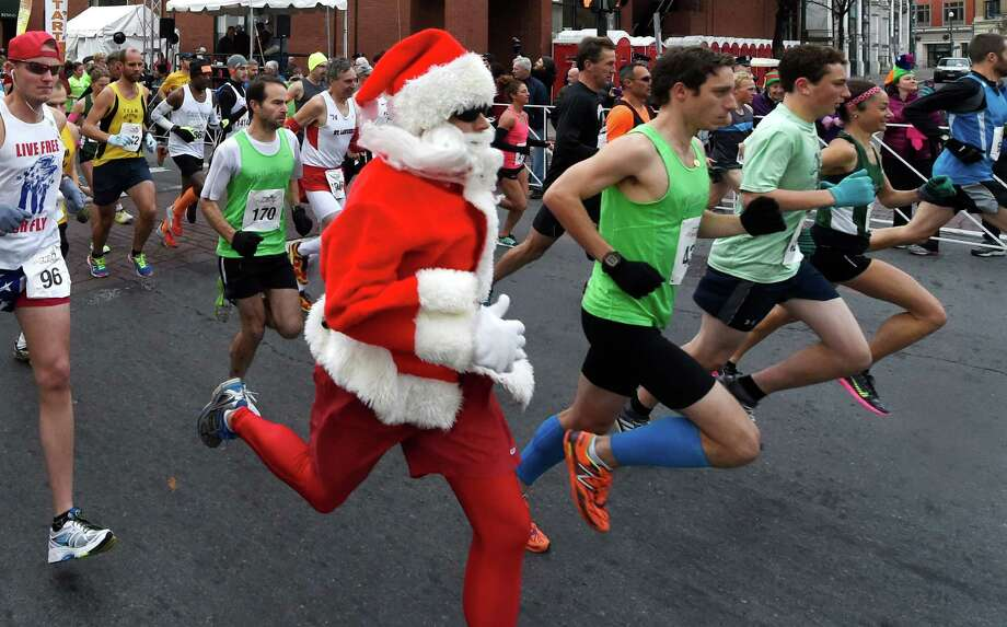 A runner dressed as Santa joins theTroy Turkey Trot 10K Thursday Nov. 26, 2015 in Troy, N.Y.     (Skip Dickstein/Times Union) Photo: SKIP DICKSTEIN / 10034423A