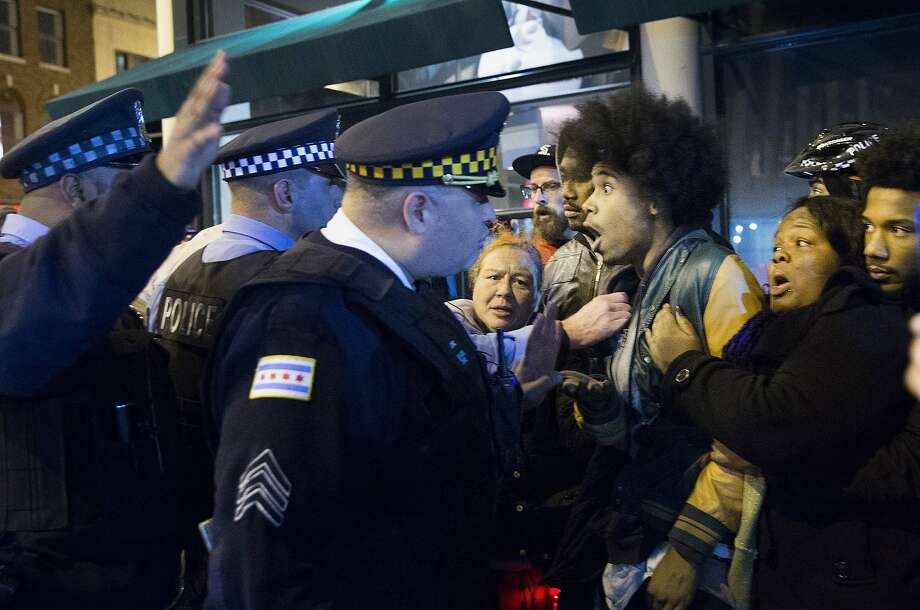 CHICAGO, IL - NOVEMBER 25:  Demonstrators confront police during a protest over the death of Laquan McDonald on November 25, 2015 in Chicago, Illinois. Small and mostly peaceful protests have sprouted up around the city following yesterday's release of a video showing Chicago Police officer Jason Van Dyke shooting and killing 17-year-old McDonald. Van Dyke has been charged with first degree murder for the October 20, 2014 shooting in which McDonald was hit with 16 bullets.  (Photo by Scott Olson/Getty Images) Photo: Scott Olson, Getty Images