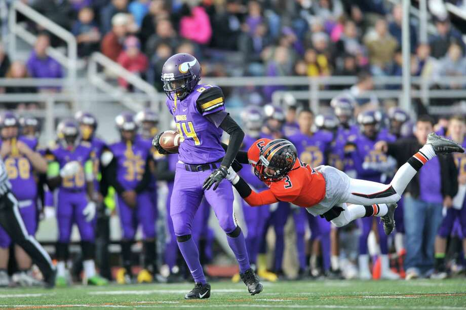Westhill receiver Wyklend Turenne avoids a Stamford defender on his way to a long gain during a Thanksgiving morning football game. Photo: Michael Cummo / Hearst Connecticut Media / Stamford Advocate