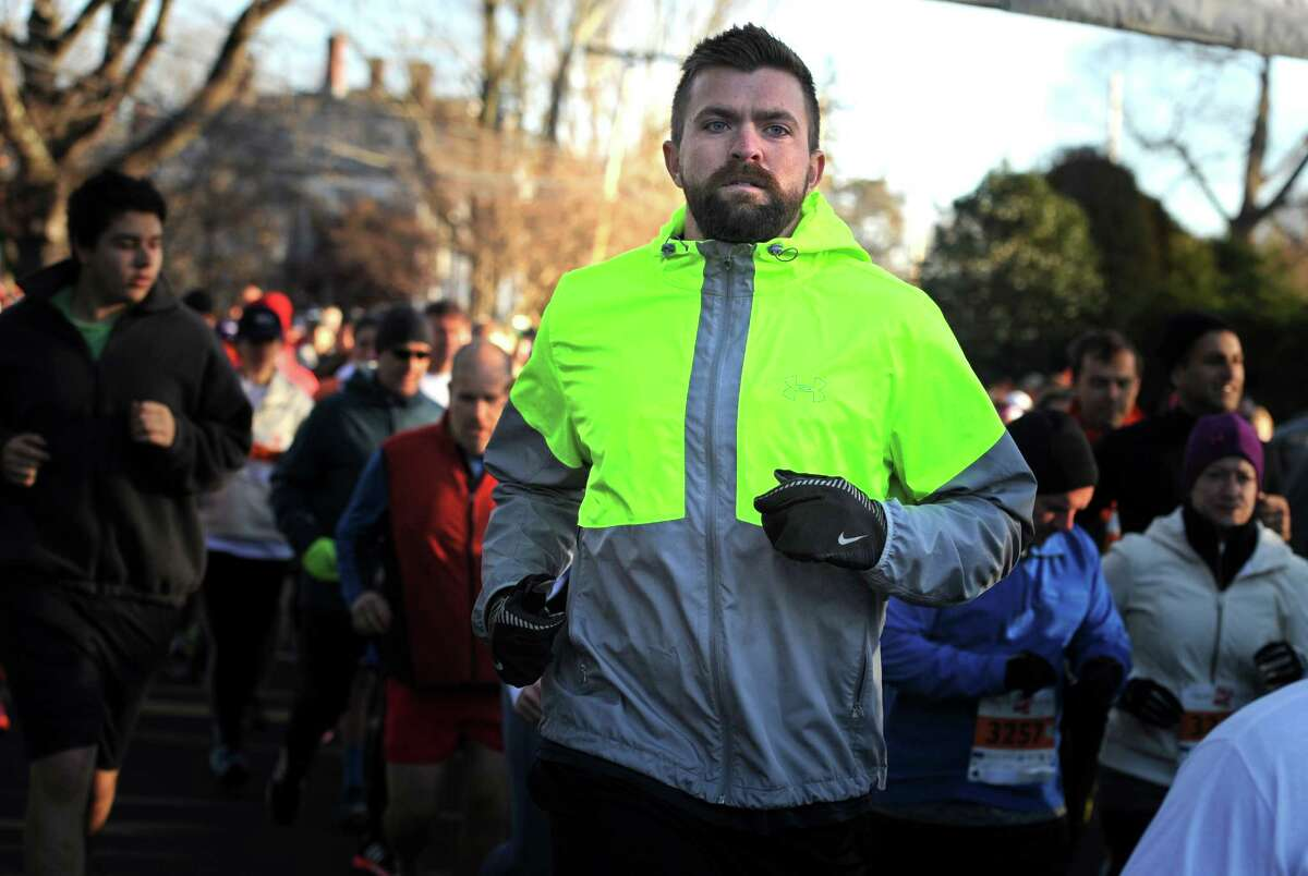 The 38th annual Pequot Runners Thanksgiving Day 5-mile race takes place Thursday, Nov. 26, 2015, in Southport, Conn.