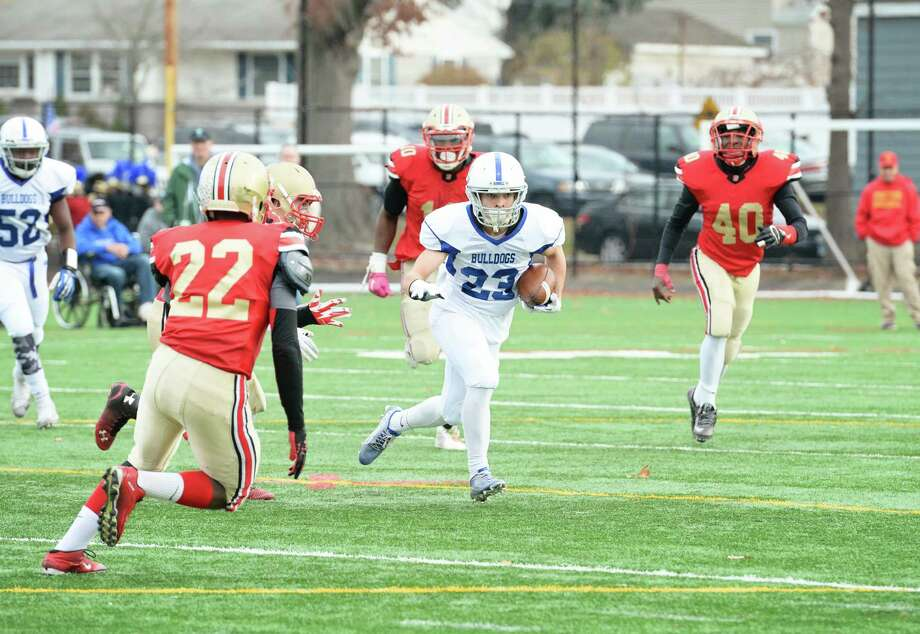 Bunnell's Jarrod Davis (23) carries the ball during the Thanksgiving Day football game against Stratford High School at Penders Field in Stratford, Conn. on Thursday, Nov. 26, 2015. Photo: Amy Mortensen / For Hearst Connecticut Media / Connecticut Post Freelance