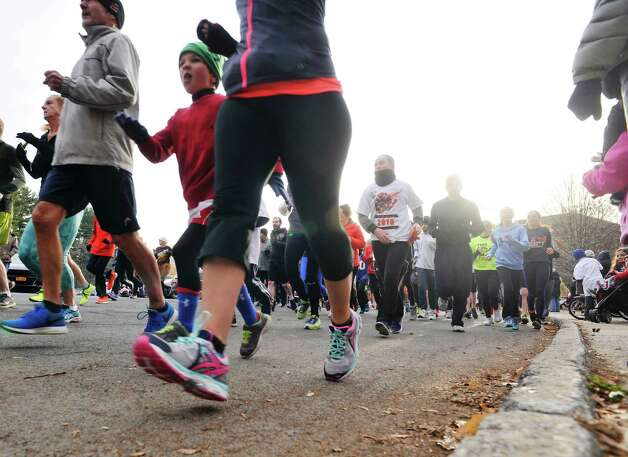 Runners head out from the starting line as they take part in the Historic Bethlehem Turkey Trot on Thursday, Nov. 26, 2015, in Delmar, N.Y. (Paul Buckowski / Times Union) Photo: PAUL BUCKOWSKI / 10034446A