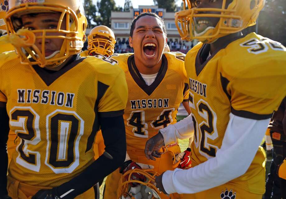 Mission's Jason Leui (44) joins teammates in celebrating in final seconds of 14-13 win over Balboa during SF Section Championship Game at Kezar Stadium in San Francisco., Calif., on Thursday, November 26, 2015. Photo: Scott Strazzante, The Chronicle
