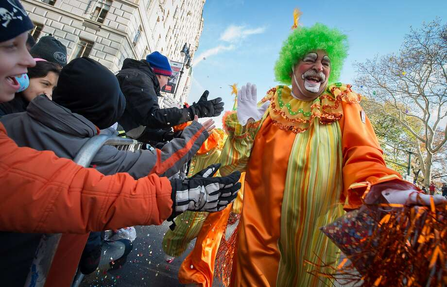 "A clown livens up the crowd during the Macy's Thanksgiving Day Parade, Thursday, Nov. 26, 2015, in New York. Unsettling reports of ""creepy clowns"" have increased since August, and clown costume sales have reportedly increased ahead of Halloween. Photo: Bryan R. Smith, Associated Press"