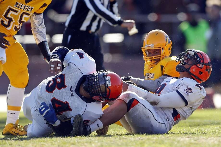 Balboa's QB Lee Lelea and Jose Henriquez are both injured on 3rd quarter play where Lelea fumbled ball near goal line during 14-13 loss to Mission during SF Section Championship Game at Kezar Stadium in San Francisco., Calif., on Thursday, November 26, 2015. Photo: Scott Strazzante, The Chronicle
