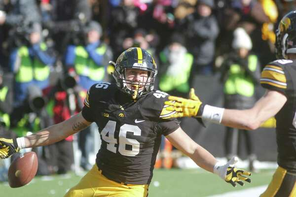 IOWA CITY, IA - NOVEMBER 21:  Tight end George Kittle #46 celebrates with wide receiver Matt VandeBerg #89 of the Iowa Hawkeyes after a touchdown in the second half against the Purdue Boilermakers on November 21, 2015 at Kinnick Stadium, in Iowa City, Iowa.  (Photo by Matthew Holst/Getty Images)