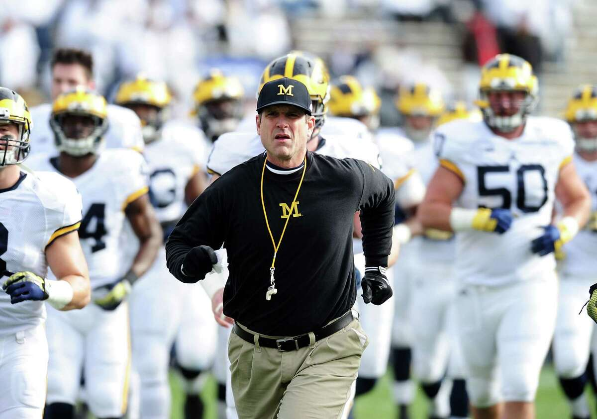 STATE COLLEGE, PA - NOVEMBER 21: Jim Harbaugh head coach of the Michigan Wolverines run onto the field prior to the game against the Penn State Nittany Lions at Beaver Stadium on November 21, 2015 in State College, Pennsylvania. (Photo by Evan Habeeb/Getty Images)