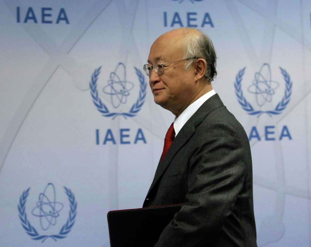 Director General of the International Atomic Energy Agency, IAEA, Yukiya Amano of Japan arrive to addresses the media for a news conference after a meeting of the IAEA board of governors at the International Center Vienna, Austria, Thursday, Nov, 26, 2015. (AP Photo/Ronald Zak)
