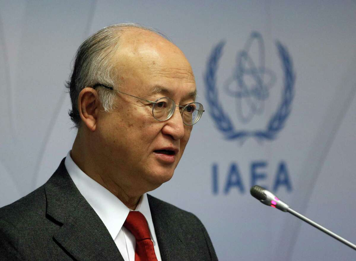 Director General of the International Atomic Energy Agency, IAEA, Yukiya Amano of Japan addresses the media during a news conference after a meeting of the IAEA board of governors at the International Center Vienna, Austria, Thursday, Nov, 26, 2015. (AP Photo/Ronald Zak)