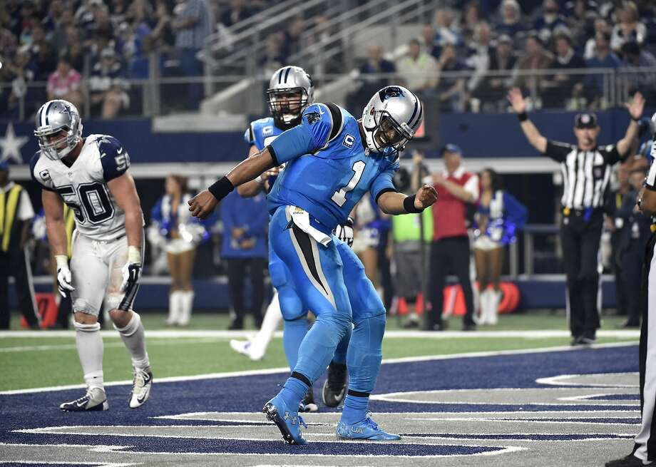 Carolina quarterback Cam Newton celebrates after a touchdown run in the Panthers' rout of host Dallas. Photo: Michael Ainsworth, Associated Press