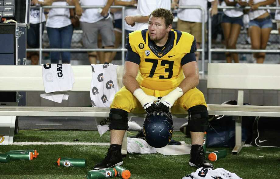 TUCSON, AZ - SEPTEMBER 20:  Offensive linesman Jordan Rigsbee #73 of the California Golden Bears reacts on the bench after being defeated by the Arizona Wildcats 49-45 on the final play of the college football game at Arizona Stadium on September 20, 2014 in Tucson, Arizona.  (Photo by Christian Petersen/Getty Images) Photo: Christian Petersen / Getty Images / 2014 Getty Images