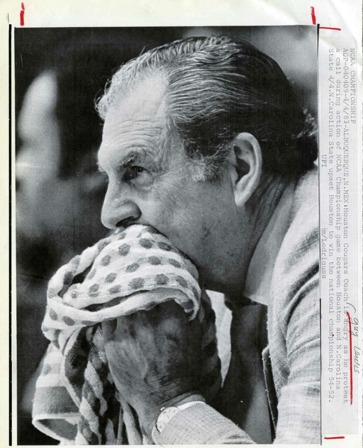 Guy Lewis - and his signature towel - led the Cougars to five NCAA Final Fours.