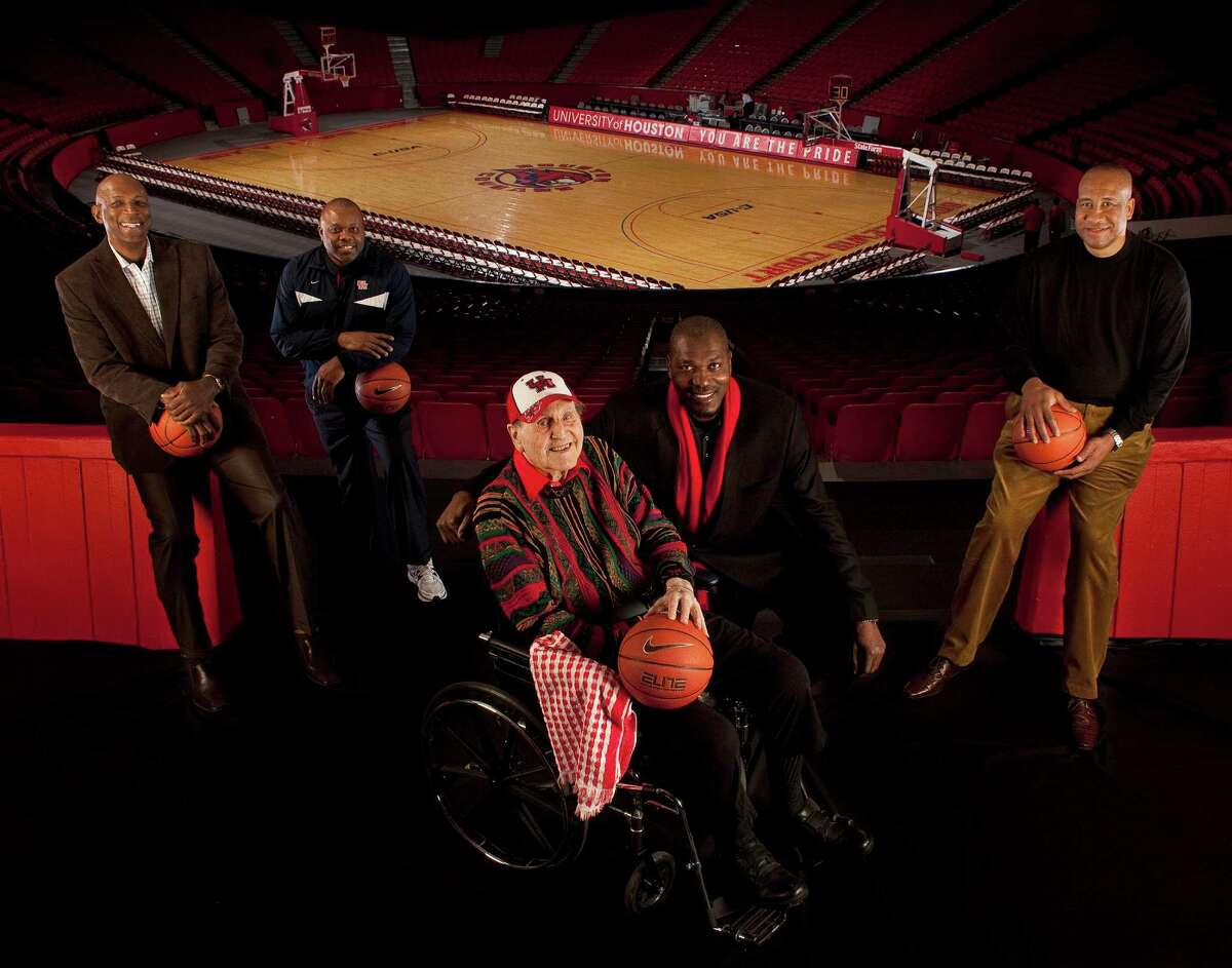 Four members of the Cougars' Phi Slama Jama fraternity of the 1980s - from left, Clyde Drexler, Michael Young, Hakeem Olajuwon and Larry Micheaux - surround coach Guy V. Lewis at Hofheinz Pavilion in 2011.
